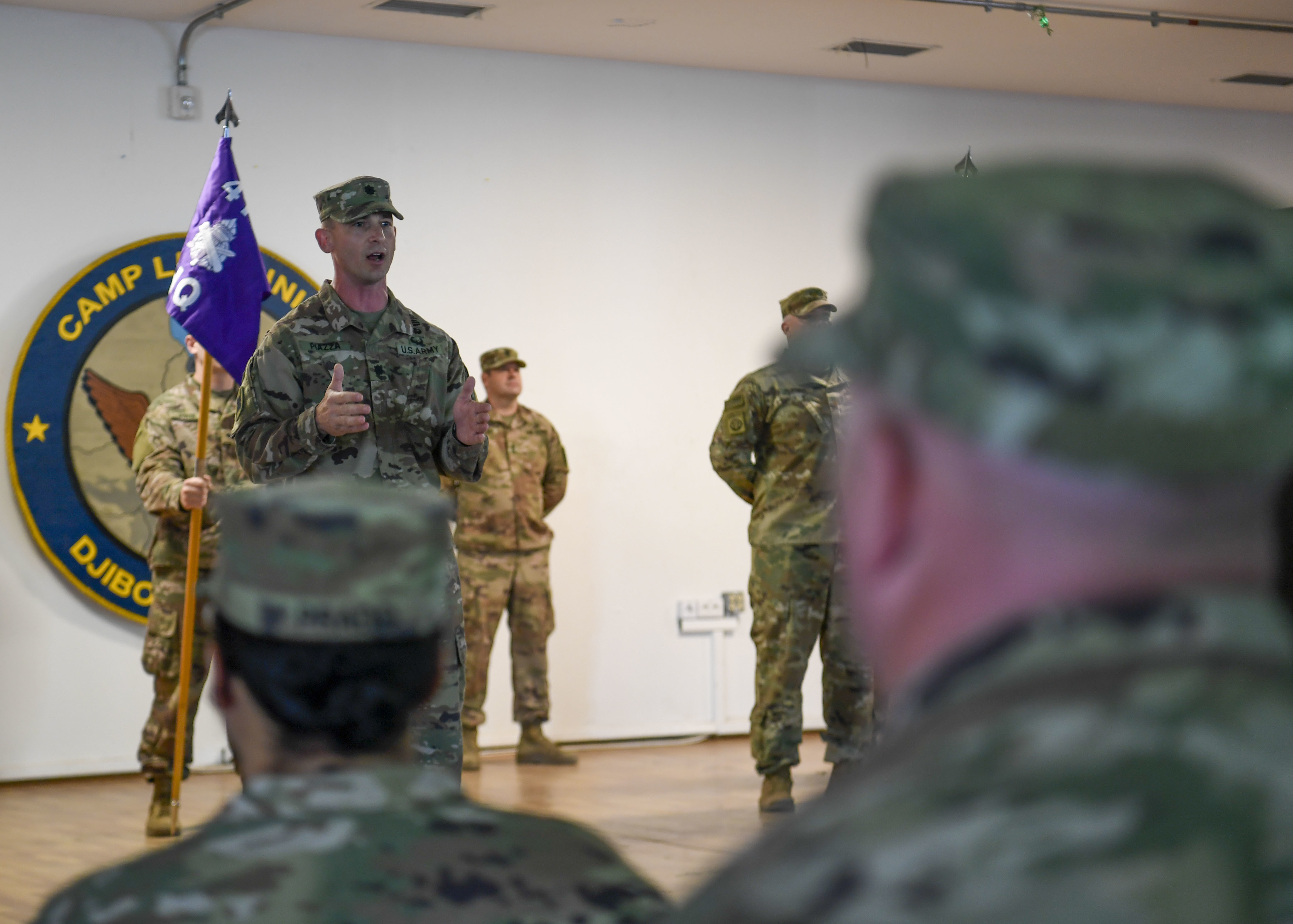 U.S. Army Lt. Col. Cecil Piazza, 411th Civil Affairs Battalion commander, assigned to Combined Joint Task Force-Horn of Africa (CJTF-HOA), speaks to his Soldiers during a transfer of authority ceremony at Camp Lemonnier, Djibouti, July 9, 2019. The 411th CA Battalion assumed civil affairs responsibilities for CJTF-HOA from the 403rd CA Battalion. Civil Affairs Soldiers are the governance and foreign-culture experts of the Army. (U.S. Air Force photo by Staff Sgt. J.D. Strong II)