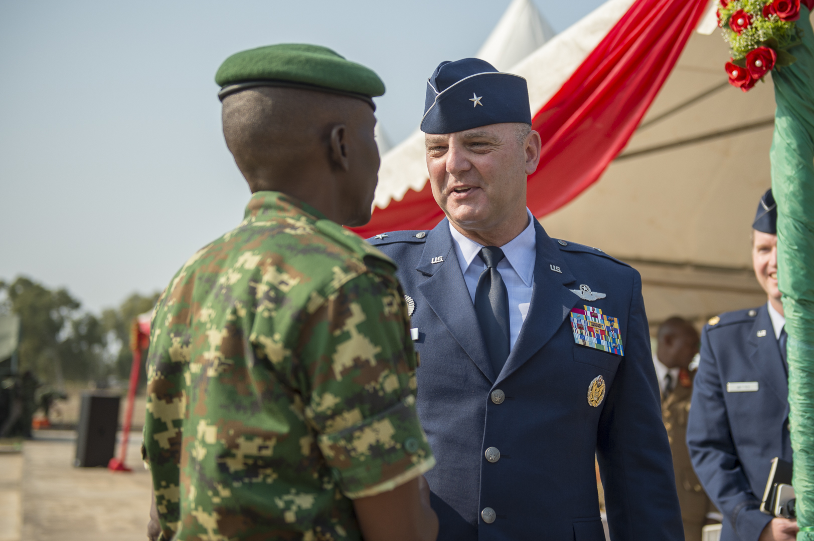 U.S. Air Force Brig. Gen. James R. Kriesel, deputy commanding general of Combined Joint Task Force-Horn of Africa, greets Burundi National Defence Force Lt. Gen. Prime Niyongabo, BNDF chief of defence, at the BNDF Senior Command and Staff College (SCSC) in Bujumbura, Burundi, July 19, 2019. The mission of the Burundi SCSC is to develop professional knowledge, skills in leadership, art and science of war to senior officers to enhance their capabilities in both command and staff duties at formation level and above. (U.S. Air Force Photo by Senior Airman Codie Trimble)