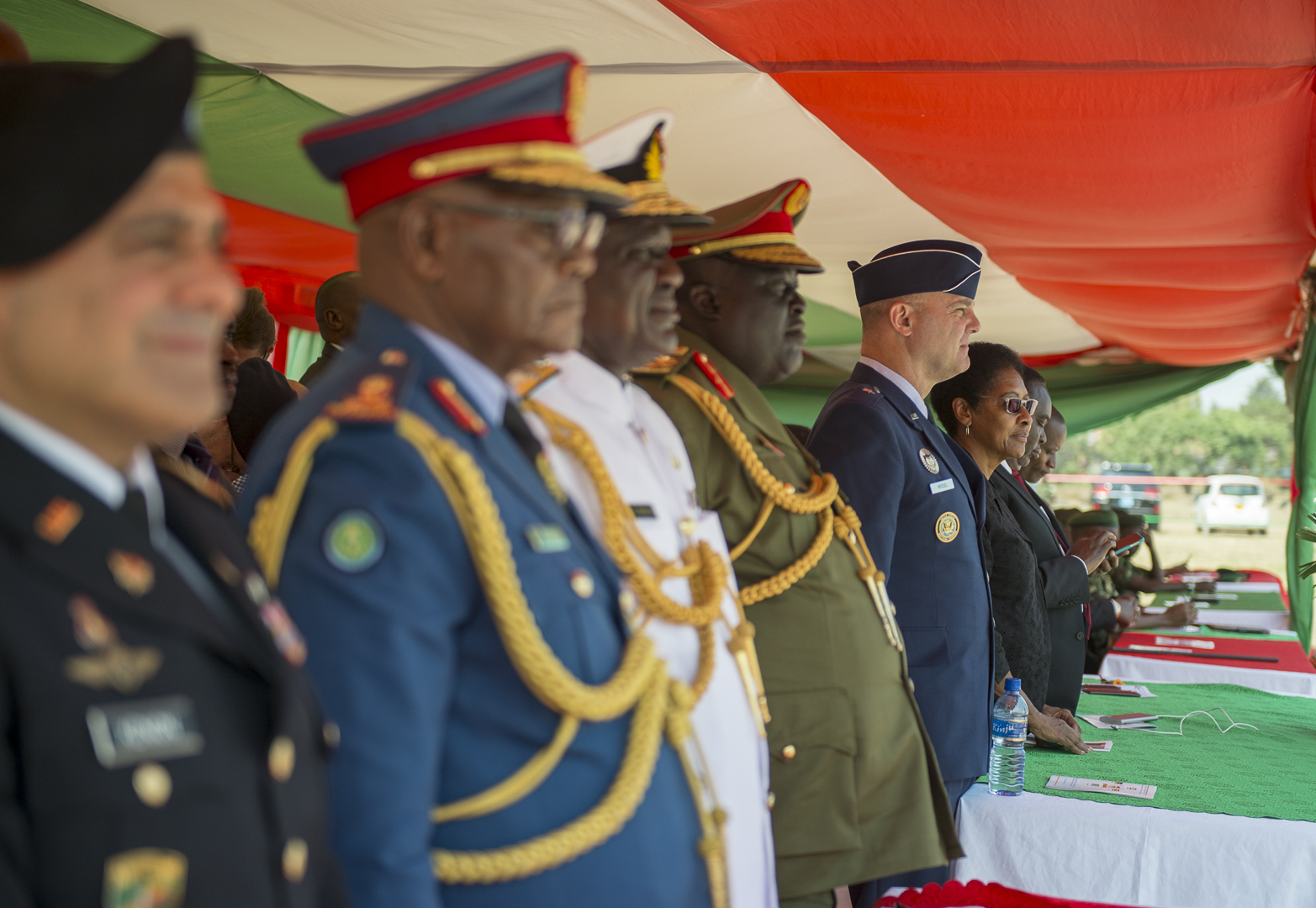 U.S. Air Force Brig. Gen. James R. Kriesel, deputy commanding general of Combined Joint Task Force-Horn of Africa, stands at attention as the graduating class of the Burundi National Defence Force Senior Command and Staff College enters in Bujumbura, Burundi, July 19, 2019. The class consisted of 28 students from four countries in the East African Community countries. (U.S. Air Force Photo by Senior Airman Codie Trimble)