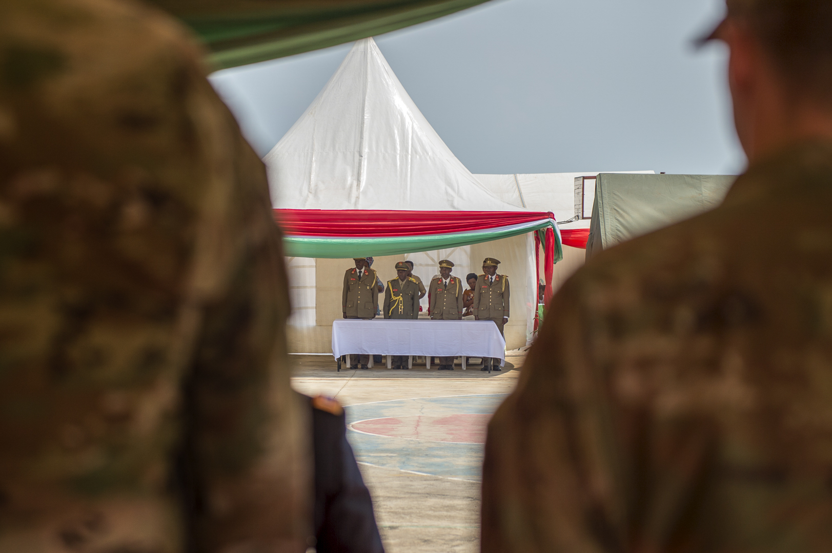 Members of the graduating class at the Burundi National Defence Force Senior Command and Staff College (SCSC) stand at attention while waiting their turn to graduate in Bujumbura, Burundi, July 19, 2019. The Burundi SCSC is a 45-week course that focuses on developing professional knowledge, skills in leadership, art and science of war to senior officers to enhance their capabilities in both command and staff duties at formation level and above. (U.S. Air Force Photo by Senior Airman Codie Trimble)