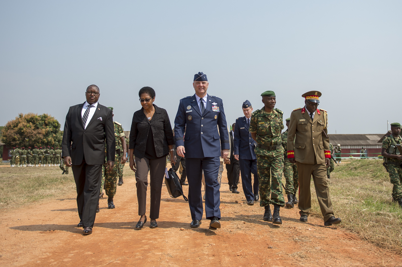 U.S. Amb. Eunice S. Reddick, the U.S. Charge d'affaires to Burundi, and former Ambassador to Gabon and Niger, and U.S. Air Force Brig. Gen. James R. Kriesel, deputy commanding general of Combined Joint Task Force-Horn of Africa, approach the graduation field at the Burundi National Defence Force Senior Command and Staff College, in Bujumbura, Burundi, July 19, 2019. The graduating class consisted of 28 students from four countries in the East African Community countries. (U.S. Air Force Photo by Senior Airman Codie Trimble)