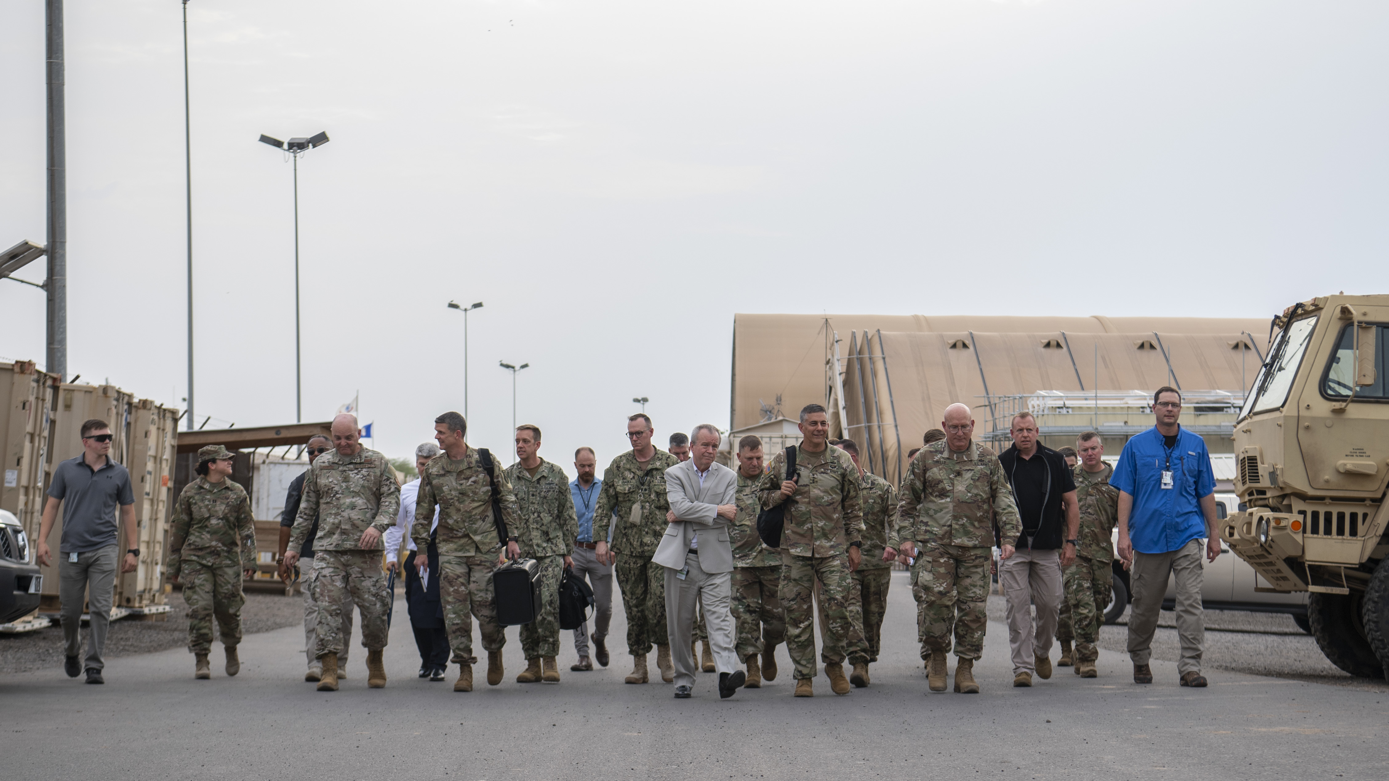 U.S. Army Gen. Stephen J. Townsend, commander, U.S. Africa Command (AFRICOM), center-right, is escorted while touring Camp Lemonnier by U.S. Army Maj. Gen. Michael Turello, commanding general, Combined Joint Task Force-Horn of Africa (CJTF-HOA), and U.S. Ambassador to Djibouti, Larry E. André at Camp Lemonnier, Djibouti, August 5, 2019. As commander of AFRICOM Townsend is in charge of military relations with African nations, the African Union and African regional security organizations. Townsend visited Djibouti as part of his familiarization of CJTF-HOA. (U.S. Air Force photo by Staff Sgt. J.D. Strong II)