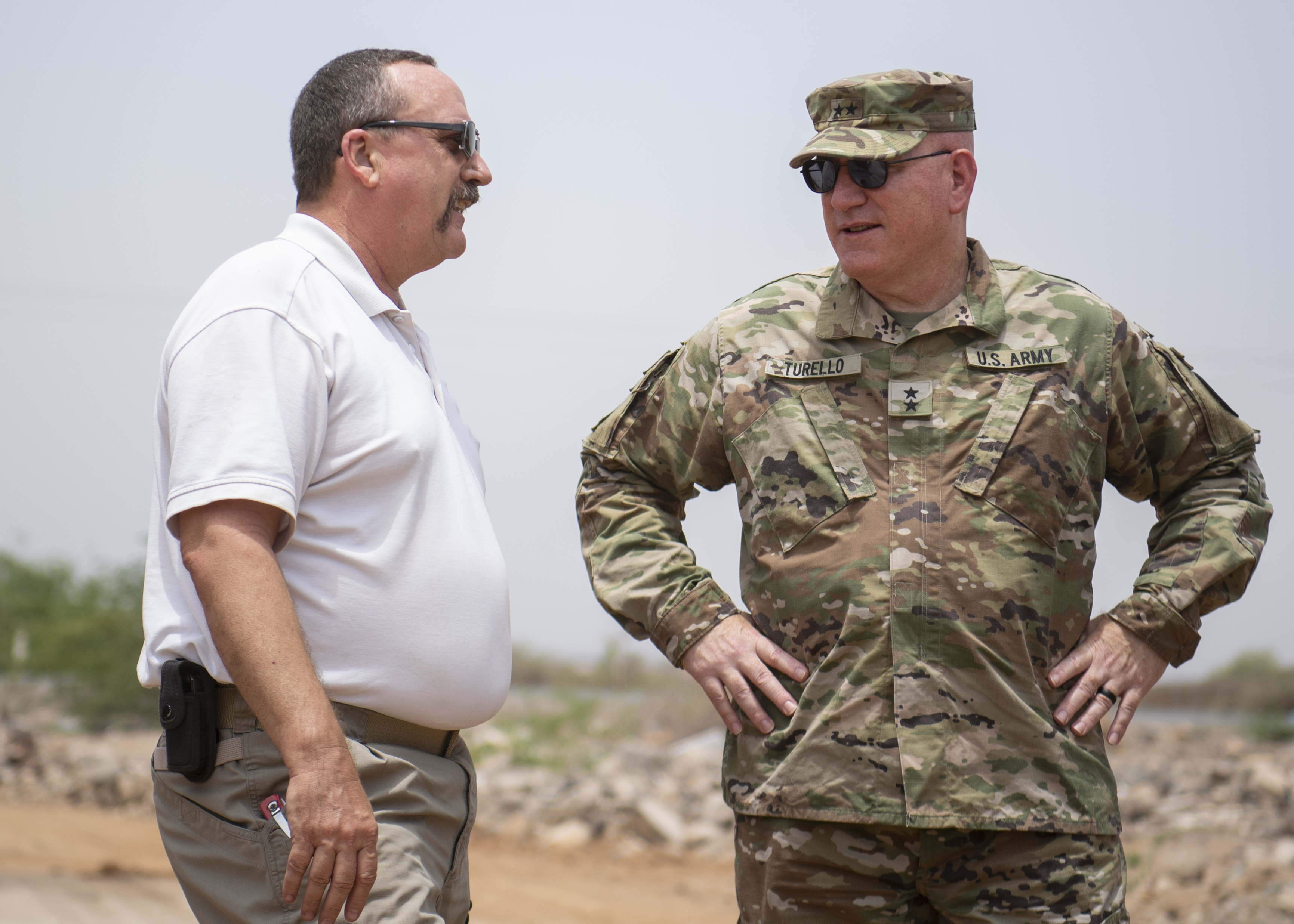 U.S. Army Maj. Gen. Michael Turello, commanding general, Combined Joint Task Force-Horn of Africa (CJTF-HOA), right, speaks with Stephen Skola, deputy fire chief, Camp Lemonnier Fire and Emergency Services, about the firefighting efforts at Douda landfill in Djibouti, Aug. 14, 2019. At the request of the government of Djibouti and in support of the U.S. Embassy Djibouti, CJTF-HOA engineers worked alongside Camp Lemonnier, Djiboutian, French and Chinese firefighters to help stop a fire at the landfill from spreading. (U.S. Air Force photo by Staff Sgt. J.D. Strong II)