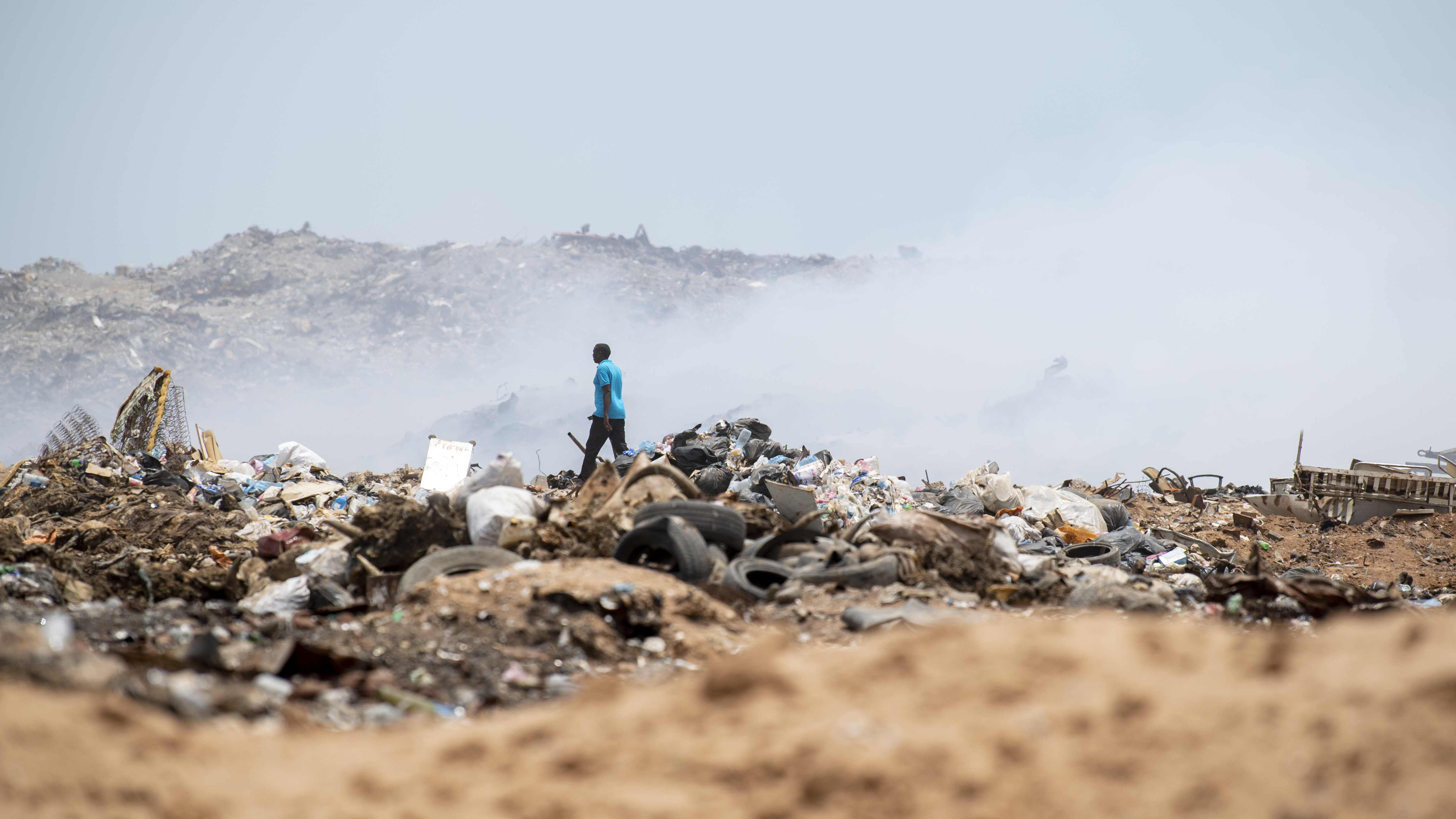 A Djiboutian Fire Brigade firefighter traverses the Douda landfill in Djibouti, Aug. 14, 2019. At the request of the government of Djibouti and in support of the U.S. Embassy Djibouti, Combined Joint Task Force-Horn of Africa engineers worked alongside Camp Lemonnier, Djiboutian, French and Chinese firefighters to help stop a fire at the landfill from spreading. (U.S. Air Force photo by Staff Sgt. J.D. Strong II)