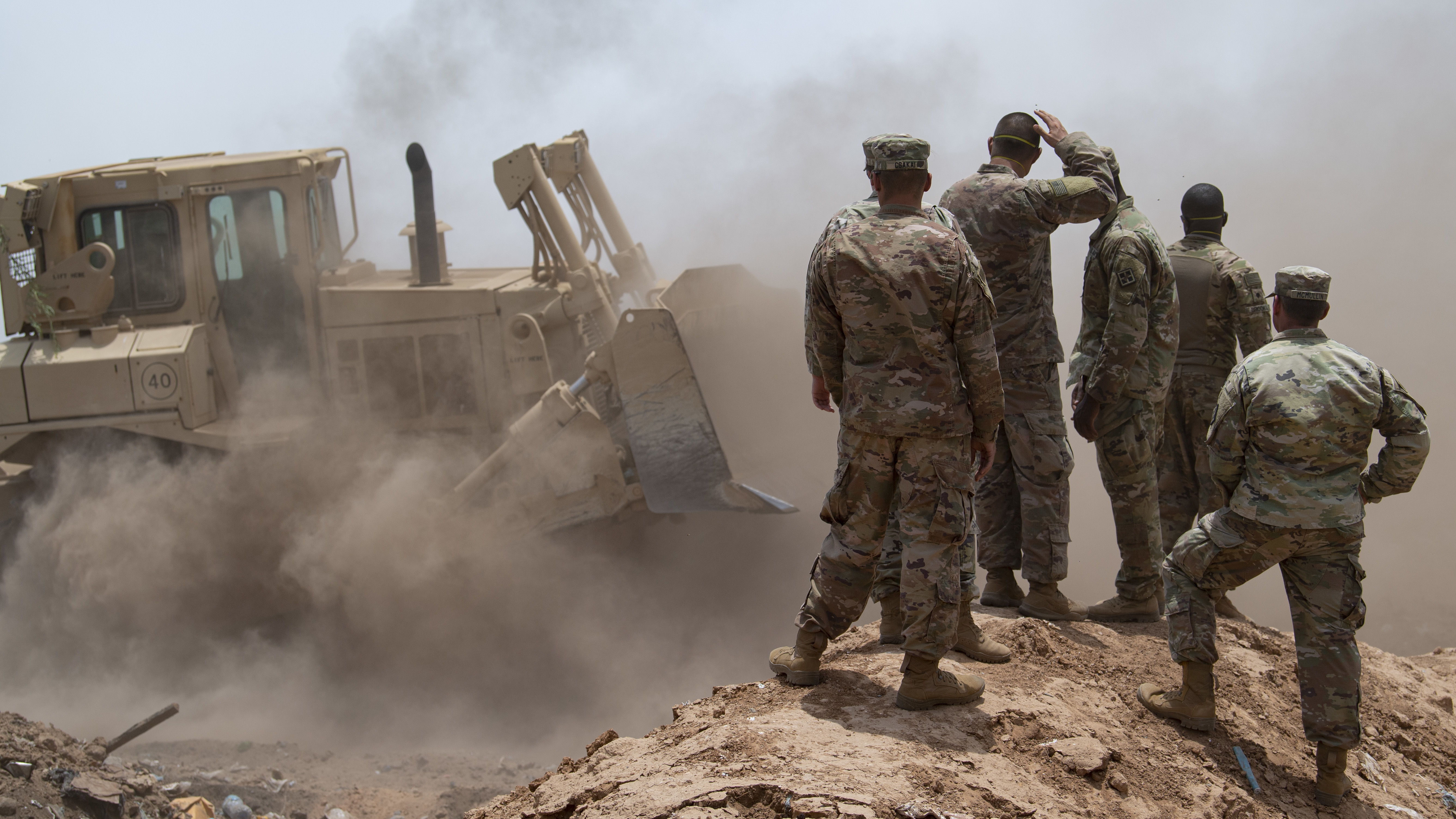 U.S. Army Soldiers from 465th Engineer Company, 926th Engineer Battalion, 926th Engineer Brigade, 412th Theater Engineer Command, based in Birmingham, Alabama, assigned to Combined Joint Task Force-Horn of Africa, assess the building of a dirt berm at the Douda landfill in Djibouti, Aug. 14, 2019. During a fire at the landfill, the 465th used bulldozers to create dirt berms that would make firebreaks and stop the flames from spreading outward. (U.S. Air Force photo by Staff Sgt. J.D. Strong II)
