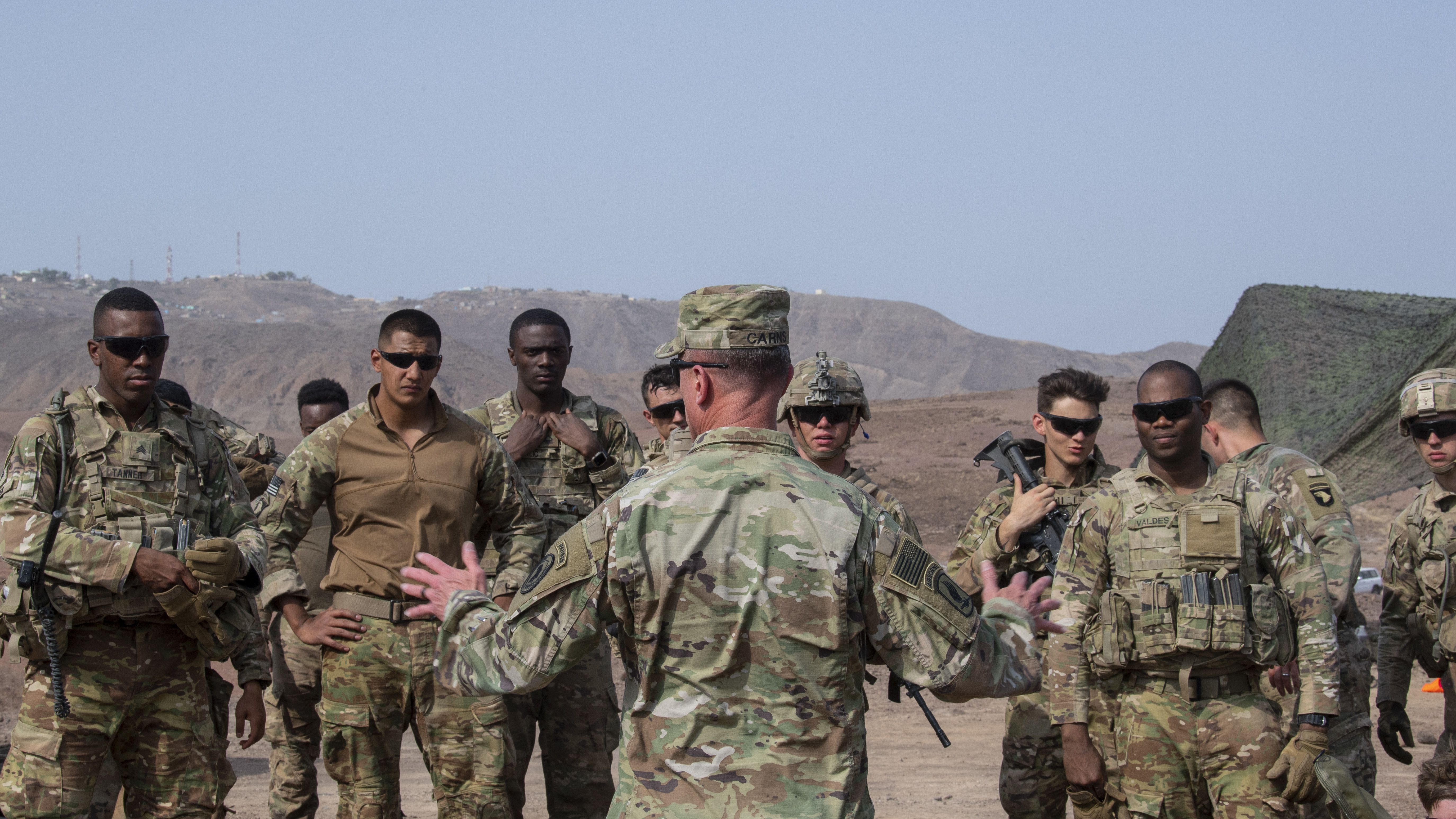 U.S. Army Command Sgt. Maj. Shawn Carns, command senior enlisted leader (SEL), Combined Joint Task Force-Horn of Africa, visits with U.S. Army Soldiers from the East African Response Force (EARF), deployed in support of Combined Joint Task Force-Horn of Africa, during his battlefield circulation visit at Arta Range, Djibouti, Aug. 26, 2019. Battlefield circulation visits allow Carns to meet with units within CJTF-HOA's combined joint operations area for familiarization and rapport-building. (U.S. Air Force photo by Staff Sgt. J.D. Strong II)