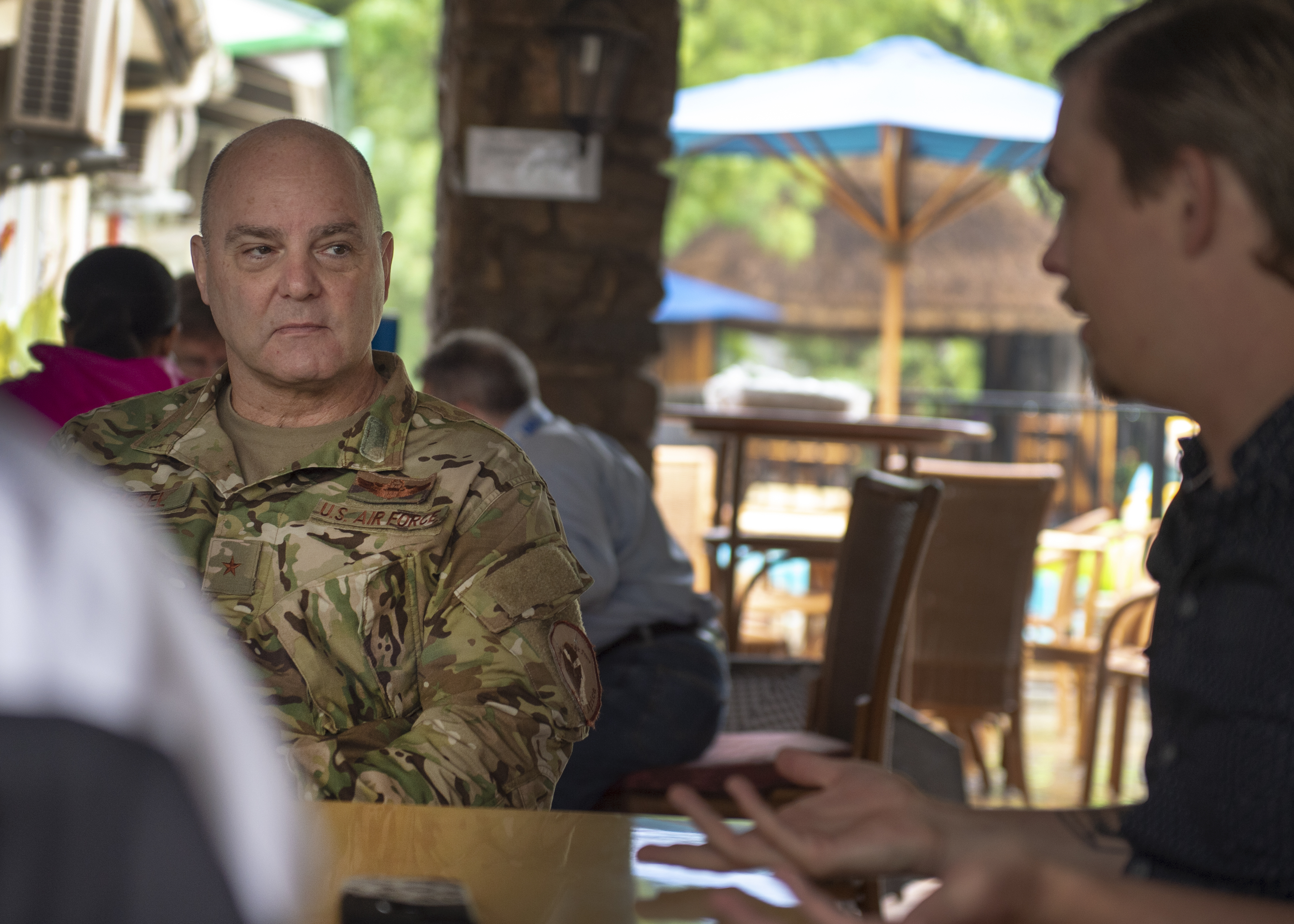 U.S. Air Force Brig. Gen. James R. Kriesel, deputy commanding general of Combined Joint Task Force-Horn of Africa (CJTF-HOA), listens to Alec Augustine-Marciel, a political officer assigned to the U.S. Embassy in South Sudan, in Juba, South Sudan August 14. Augustine-Marciel briefed Kriesel on the ever-changing political landscape in South Sudan. (U.S. Air Force Photo by Senior Airman Codie Trimble)