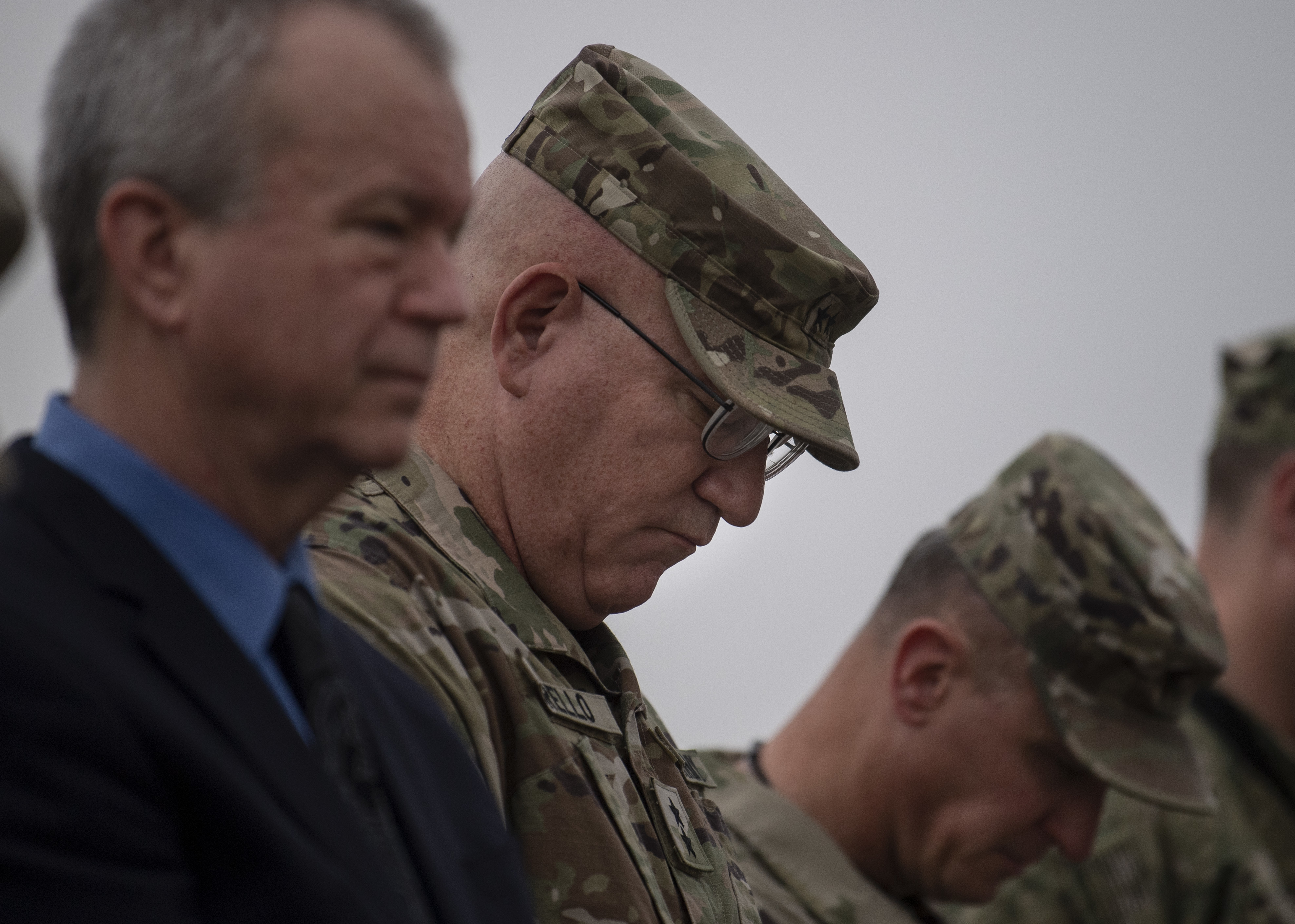 U.S. Army Maj. Gen. Michael Turello, commanding general, Combined Joint Task Force-Horn of Africa, right, Amb. Larry André, U.S. Ambassador to Djibouti, reflect during the invocation of the 9/11remembrance ceremony at Camp Lemonnier, Djibouti, Sept. 11, 2019. The ceremony honored those who lost their lives in New York City, Washington D.C. and Pennsylvania 18 years ago. (U.S. Air Force photo by Staff Sgt. J.D. Strong II)