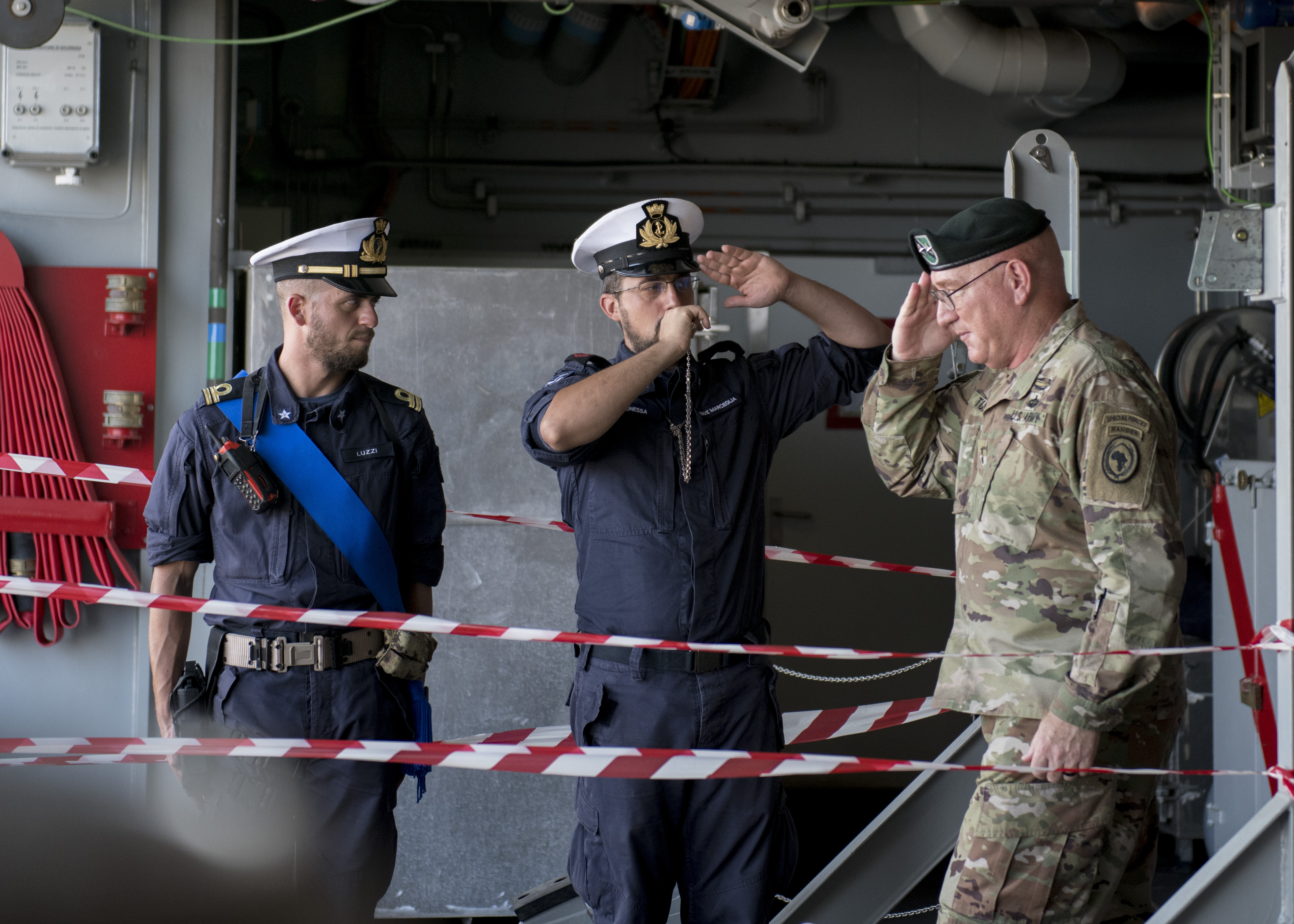 U.S. Army Maj. Gen. Michael D. Turello, commanding general of Combined Joint Task Force-Horn of Africa, renders a salute upon disembarking ITS Antonio Marceglia outside Djibouti City, Djibouti, Oct. 21, 2019. ITS Antonio Marceglia is the flagship of Operation Atalanta, a counter-piracy naval military operation off the Horn of Africa. (U.S. Air Force Photo by Senior Airman Codie Trimble)
