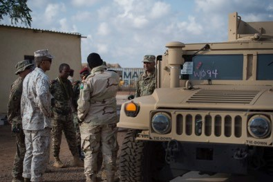 U.S. Marine Corps Capt. Adrian Lopez, Rapid Intervention Battalion (RIB) project officer assigned to CJTF-HOA, meets with Djiboutian Armed Forces Maj. Mohamed Assoweh, RIB commander, during the delivery of Humvees to the RIB outside Djibouti City, Djibouti, on Dec. 26th. The U.S. delivered 54 Humvees to the RIB as part of a $31 million train-and-equip partnership between the U.S. government and the Djiboutian military. (U.S. Air Force Photo by Senior Airman Codie Trimble)