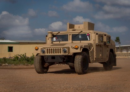 A Humvee is delivered to the Djiboutian Armed Forces' Rapid Intervention Battalion (RIB) compound outside Djibouti City, Djibouti, on Dec. 26th. The U.S. delivered 54 Humvees to the RIB as part of a $31 million train-and-equip partnership between the U.S. government and the Djiboutian military. (U.S. Air Force Photo by Senior Airman Codie Trimble)