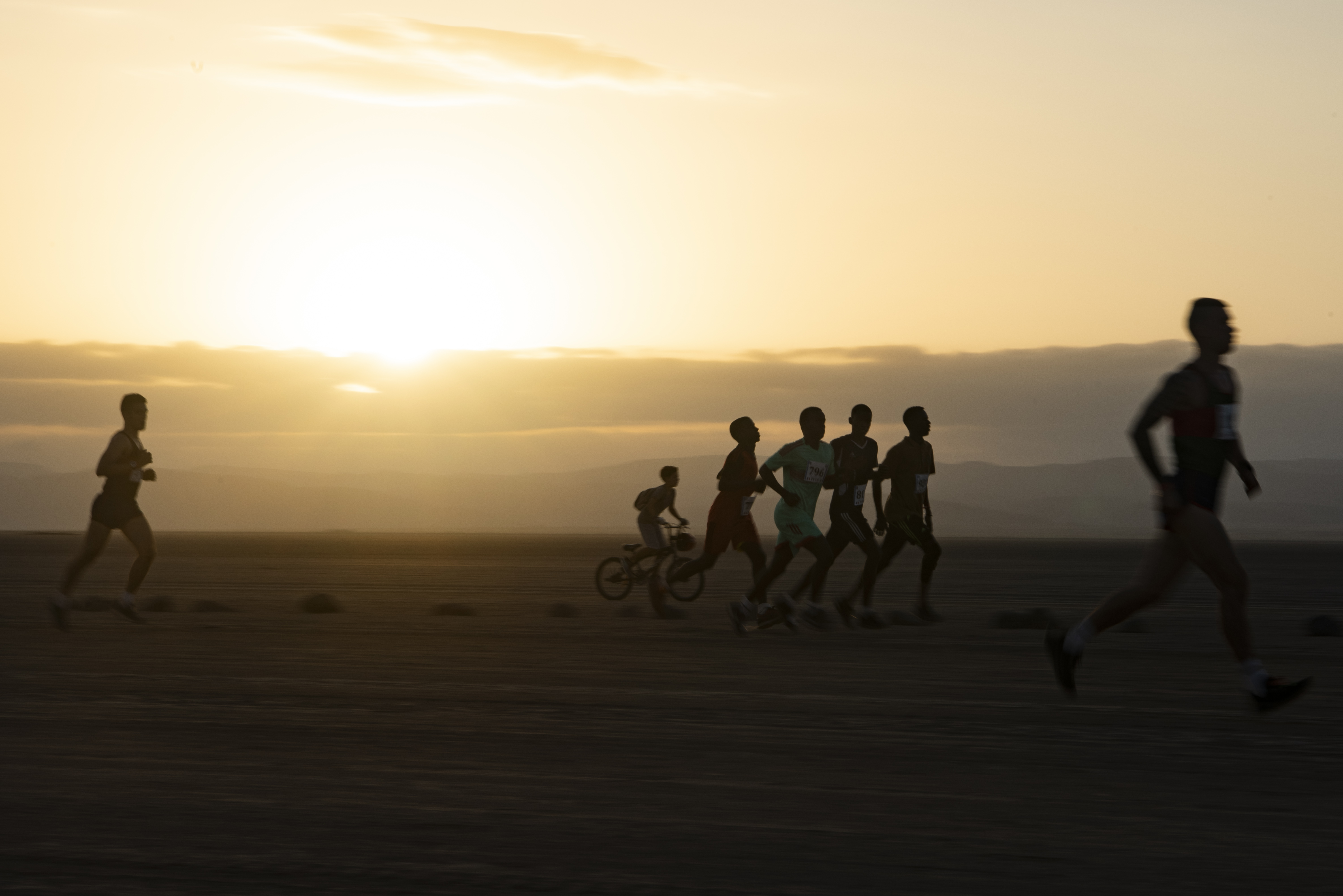 Participants of the Grand Bara Race run along the 15k trail as the sun rises over the Grand Bara Desert, Djibouti, Jan. 15, 2020.  The annual race is typically held during November or December, but was postponed in 2019 due to excessive rain. (U.S. Air Force photo by Tech. Sgt. Ashley Nicole Taylor)