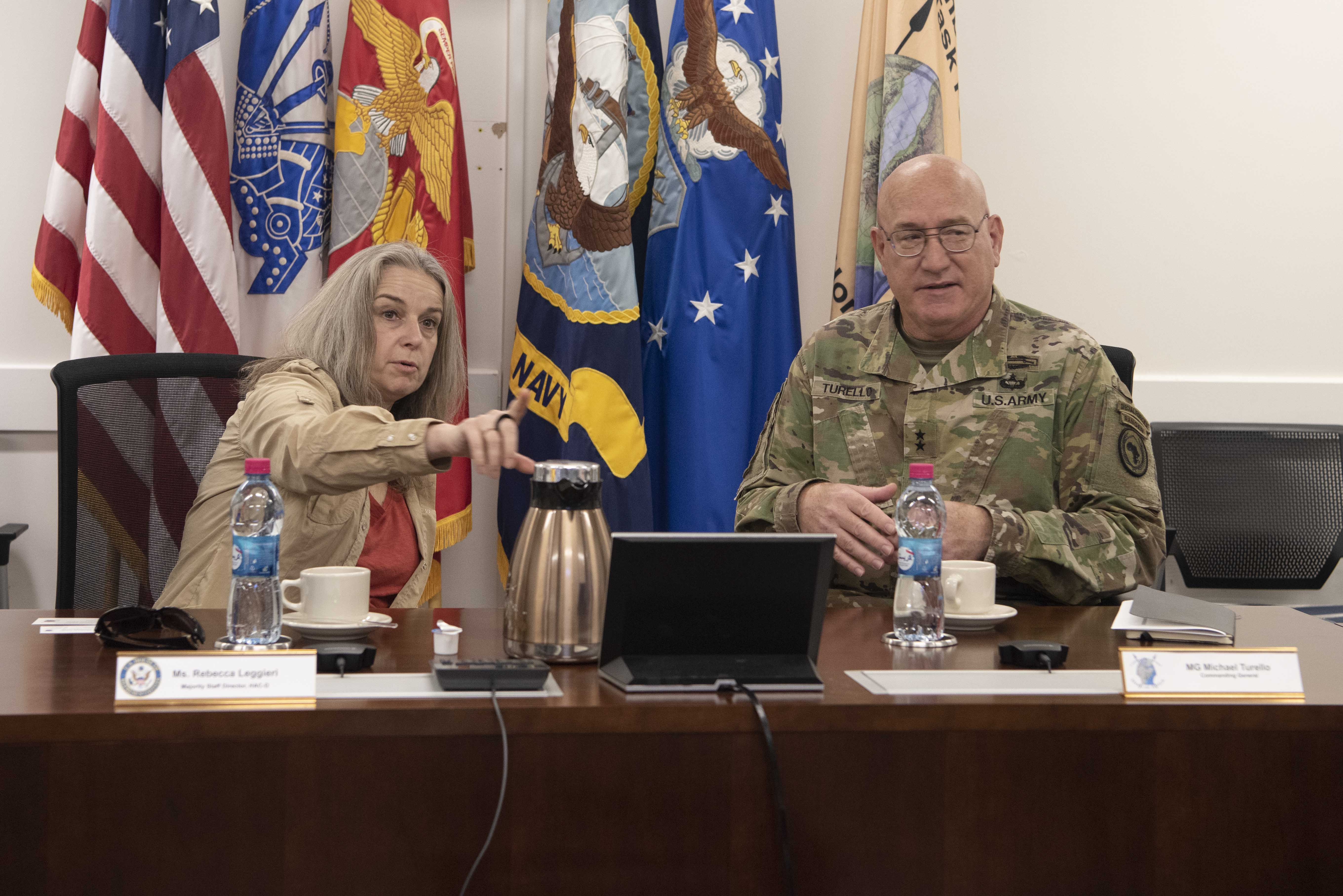 U.S. Army Maj. Gen. Michael D. Turello, commanding general, Combined Joint Task Force-Horn of Africa (CJTF-HOA), right; meets with Rebecca Leggieri, majority staff director, House Appropriations Subcommittee on Defense, at Camp Lemonnier, Djibouti, (CLDJ), Jan. 21, 2020. Leggieri, along with other staff members, visited CLDJ to learn about the CJTF-HOA mission. (U.S. Air Force photo by Tech. Sgt. Ashley Nicole Taylor)