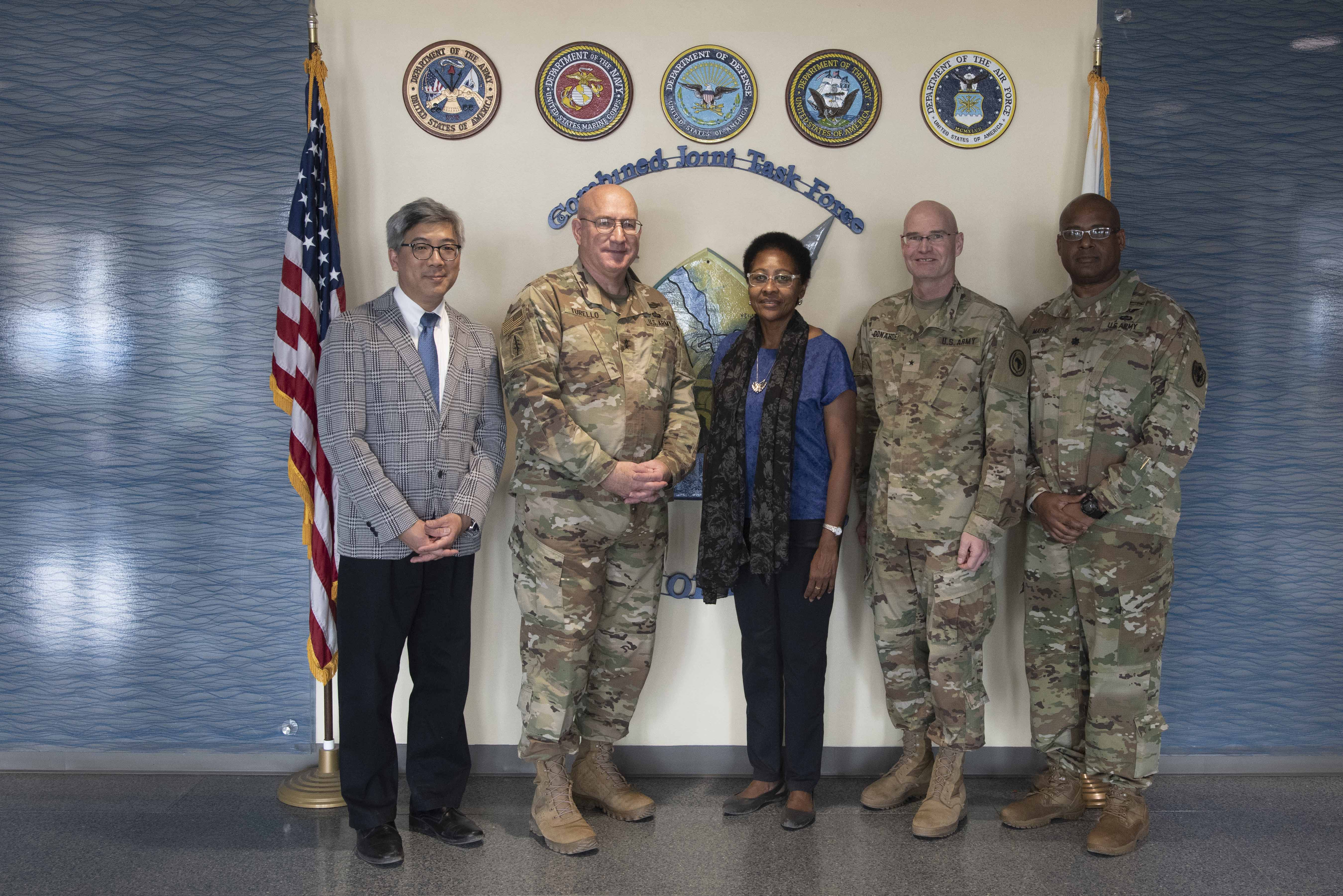 U.S. Army Maj. Gen. Michael D. Turello, center left, commanding general of Combined Joint Task Force-Horn of Africa (CJTF-HOA), welcomes Ambassador Eunice S. Reddick, Chargé d'affaires of the U.S. Embassy to Burundi, at Camp Lemonnier, Djibouti, Jan. 31, 2020. Reddick visited to learn more about the CJTF-HOA mission. (U.S. Air Force photo by Tech. Sgt. Ashley Nicole Taylor)
