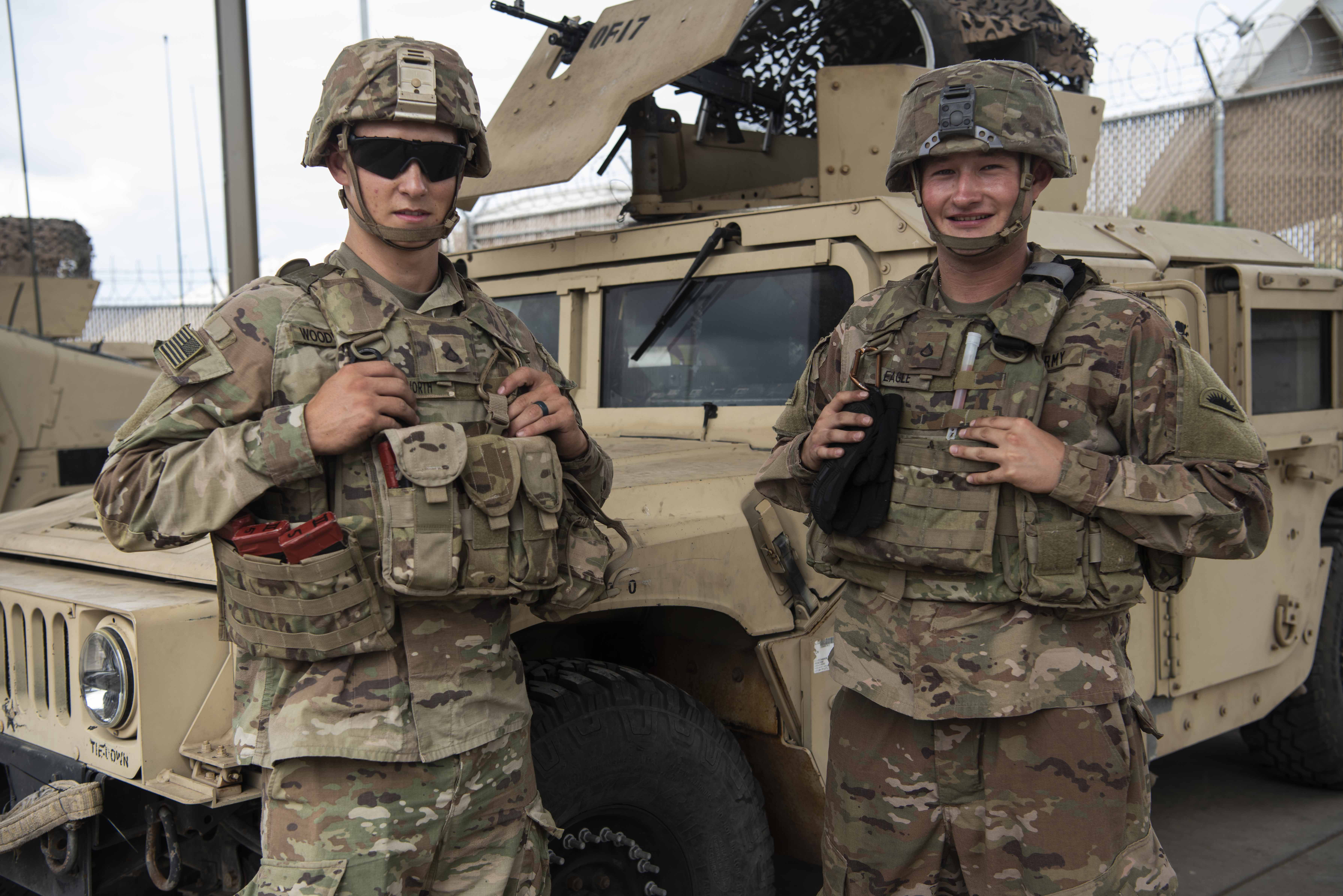 U.S. Army Pfc. Brodi Woodworth, driver and gunner for 3rd Platoon, Delta Company, Task Force Guardian (TFG) (left), and Pfc. Tyoma Eagle, driver and gunner for 4th Platoon, Delta Company, TFG (right), both assigned to Combined Joint Task Force – Horn of Africa, complete a pre-combat inspection (PCI) on a Humvee M1152, at Camp Lemonnier, Djibouti, Feb. 4, 2020. Woodworth and Eagle are members of the Quick Response Force (QRF), a unit on standby to respond to any incidents involving U.S. citizens who need assistance. (U.S. Air Force photo by Tech. Sgt. Ashley Nicole Taylor)