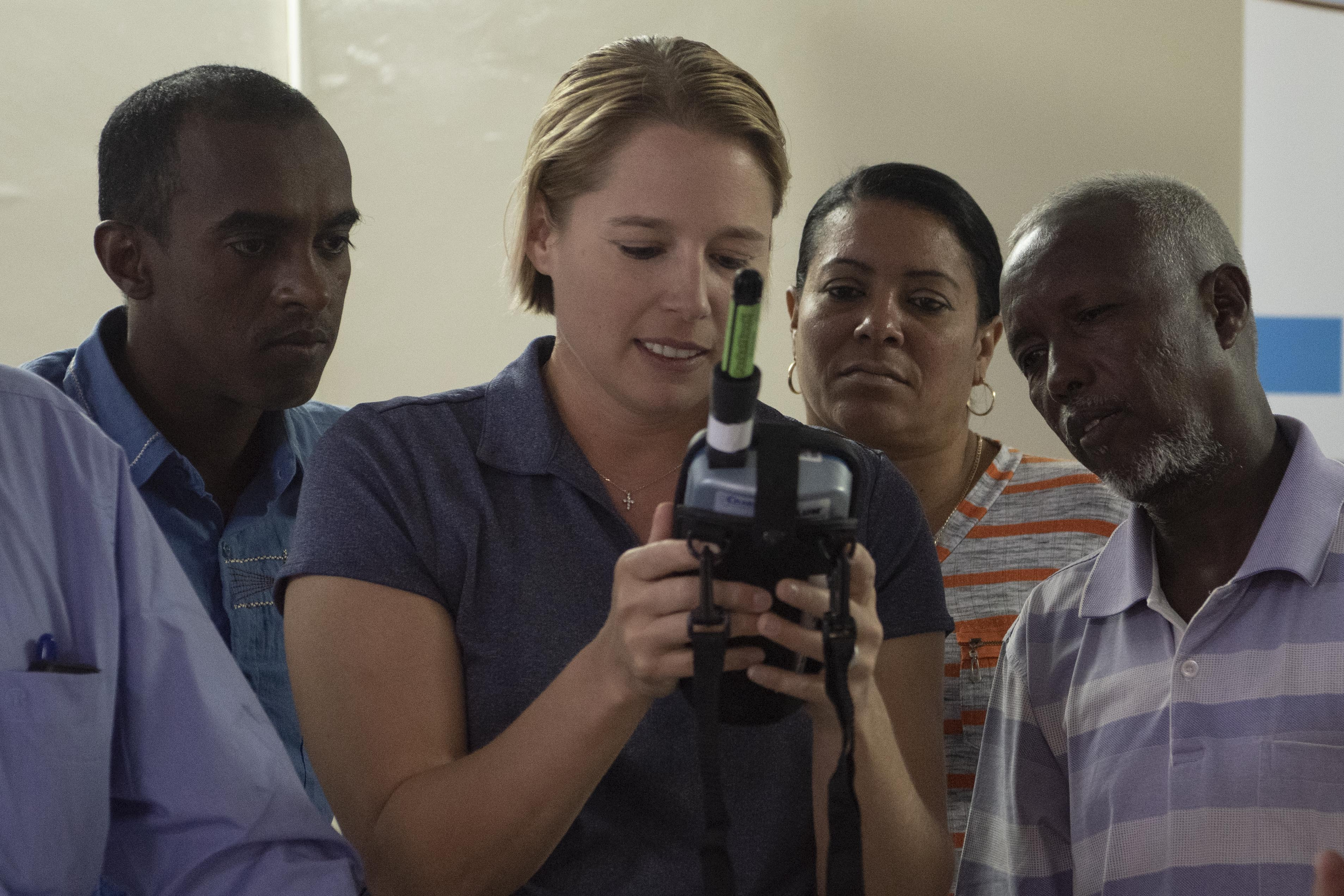 U.S. Army Maj. Stephanie Wire, veterinarian of the 411th Civil Affairs Functional Specialty Team, assigned to Combined Joint Task Force – Horn of Africa, demonstrates how to conduct a food surface swab test during a seminar with members from the Ministry of Agriculture, Livestock and Fisheries Djibouti Veterinary Services Division, in Djibouti City, Djibouti, Jan. 30, 2020. (U.S. Air Force photo by Tech. Sgt. Ashley Nicole Taylor)