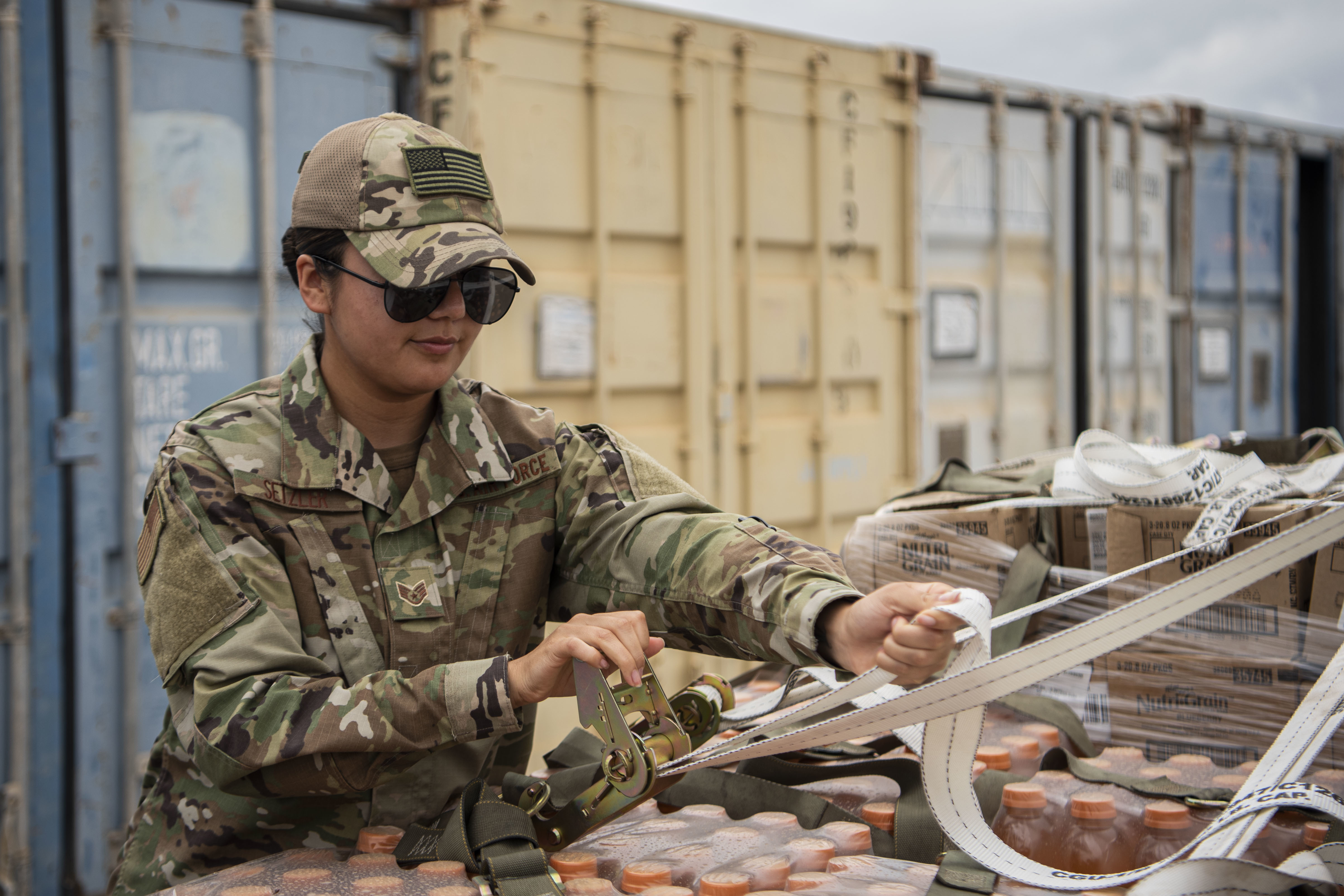 U.S. Air Force Staff Sgt. Andrea Setzler, air movements noncommissioned officer in charge, Combined Joint Task Force-Horn of Africa (CJTF-HOA), secures cargo for transport at Camp Lemonnier, Djibouti, Feb. 4, 2020. Setzler manages the first step in transporting cargo throughout the CJTF-HOA area of operations, ensuring U.S. forces in the region have the supplies needed to maintain stability in East Africa. (U.S. Air Force photo by Senior Airman Gage Daniel)