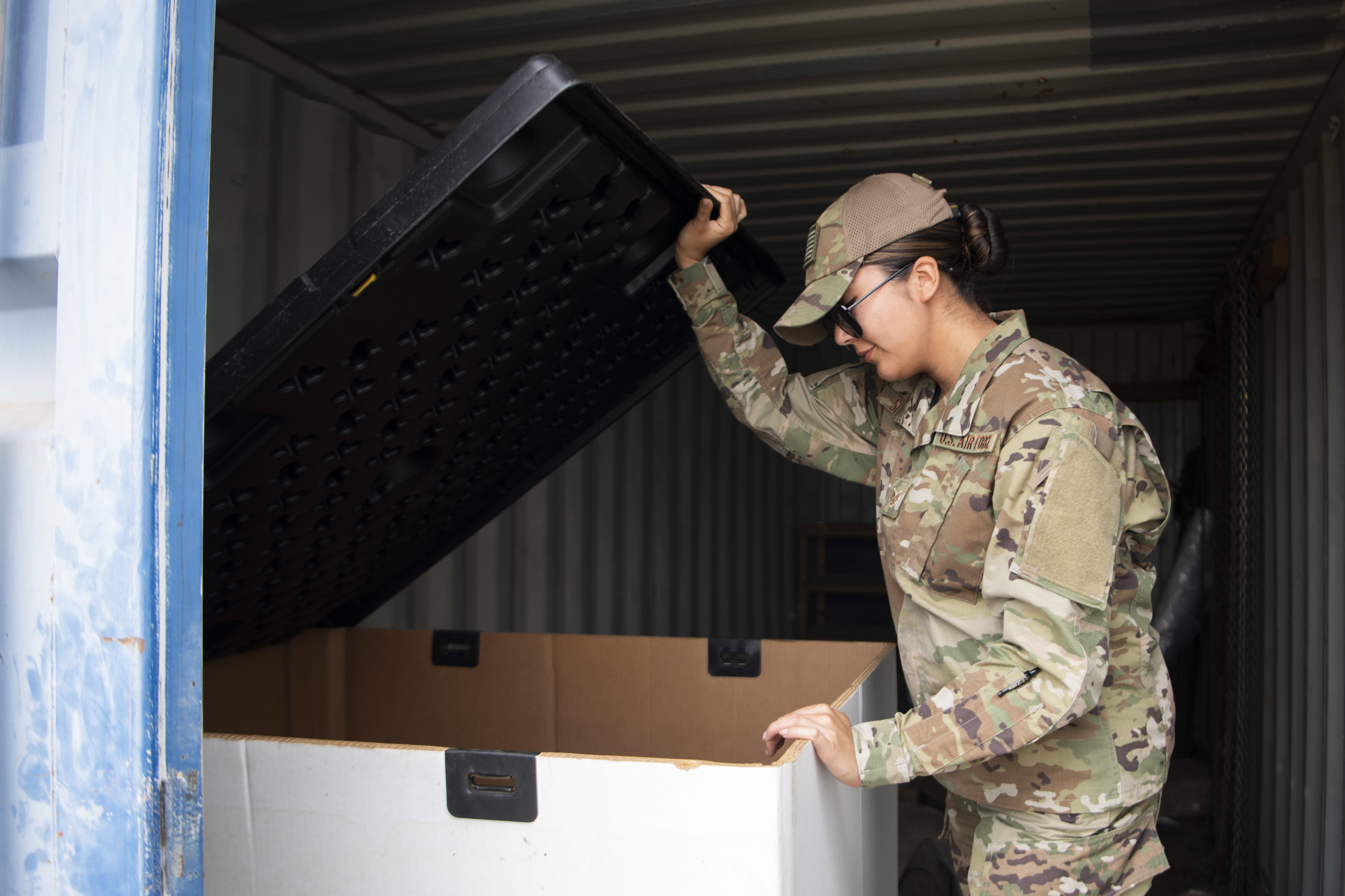 U.S. Air Force Staff Sgt. Andrea Setzler, air movements noncommissioned officer in charge, Combined Joint Task Force-Horn of Africa (CJTF-HOA), inspects a transportation equipment container at Camp Lemonnier, Djibouti, Feb. 4, 2020. Setzler manages the first step in transporting cargo throughout the CJTF-HOA area of operations, ensuring U.S. forces in the region have the supplies needed to maintain stability in East Africa.  (U.S. Air Force photo by Senior Airman Gage Daniel)
