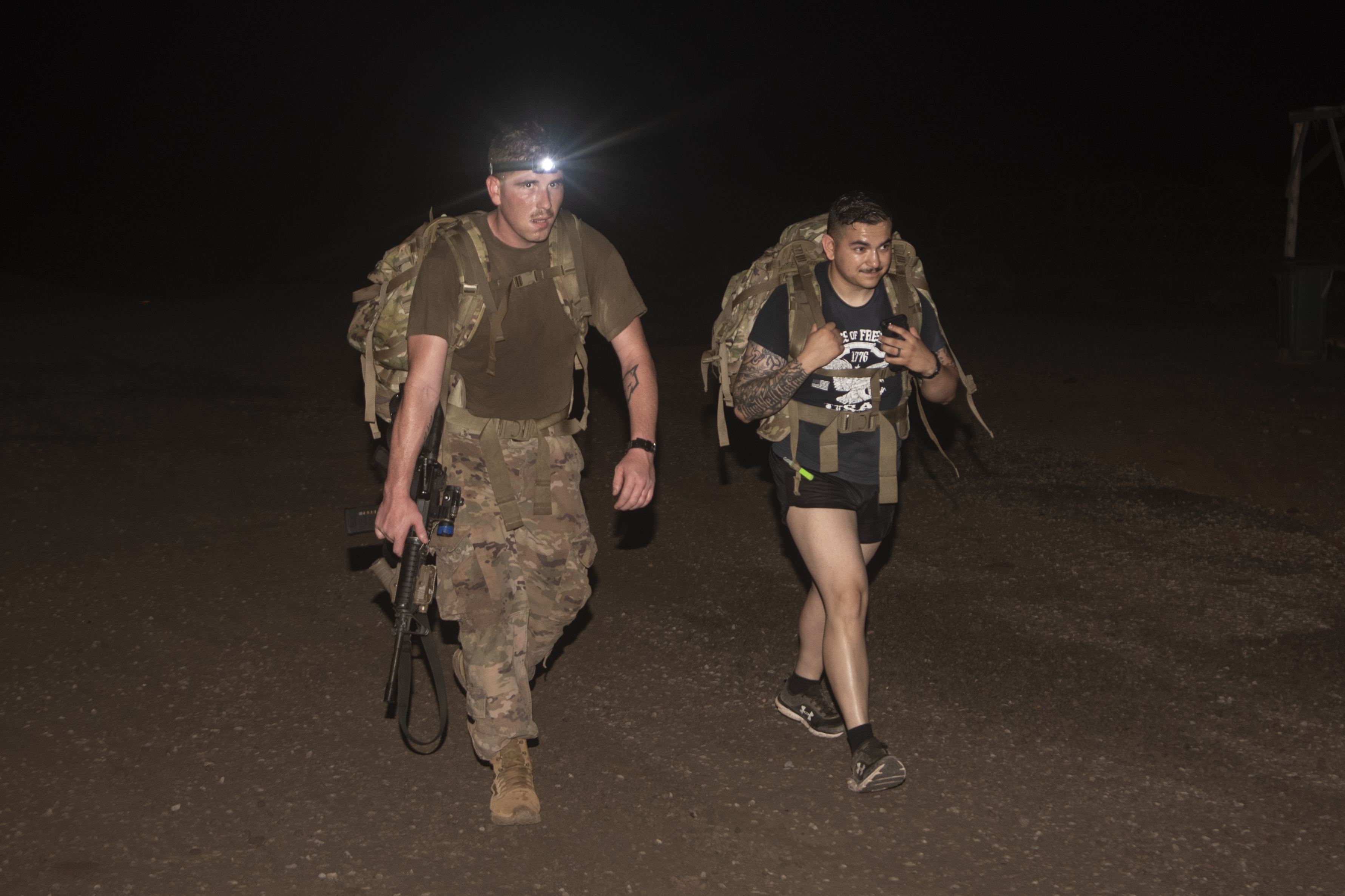 U.S. Army Soldiers assigned to 1-200th Infantry Battalion, Task Force Guardian, Combined Joint Task Force-Horn of Africa, ruck march during the Bataan Memorial Death March at Chabelley Airfield, Djibouti, March 15, 2020. The New Mexico National Guard's 1-200th Infantry Battalion hosts an annual Bataan Memorial Death March at White Sands National Park, New Mexico, to honor the Prisoner of War Soldiers who were force-marched in the Philippines during World War II. (U.S. Air Force photo by Senior Airman Gage Daniel)