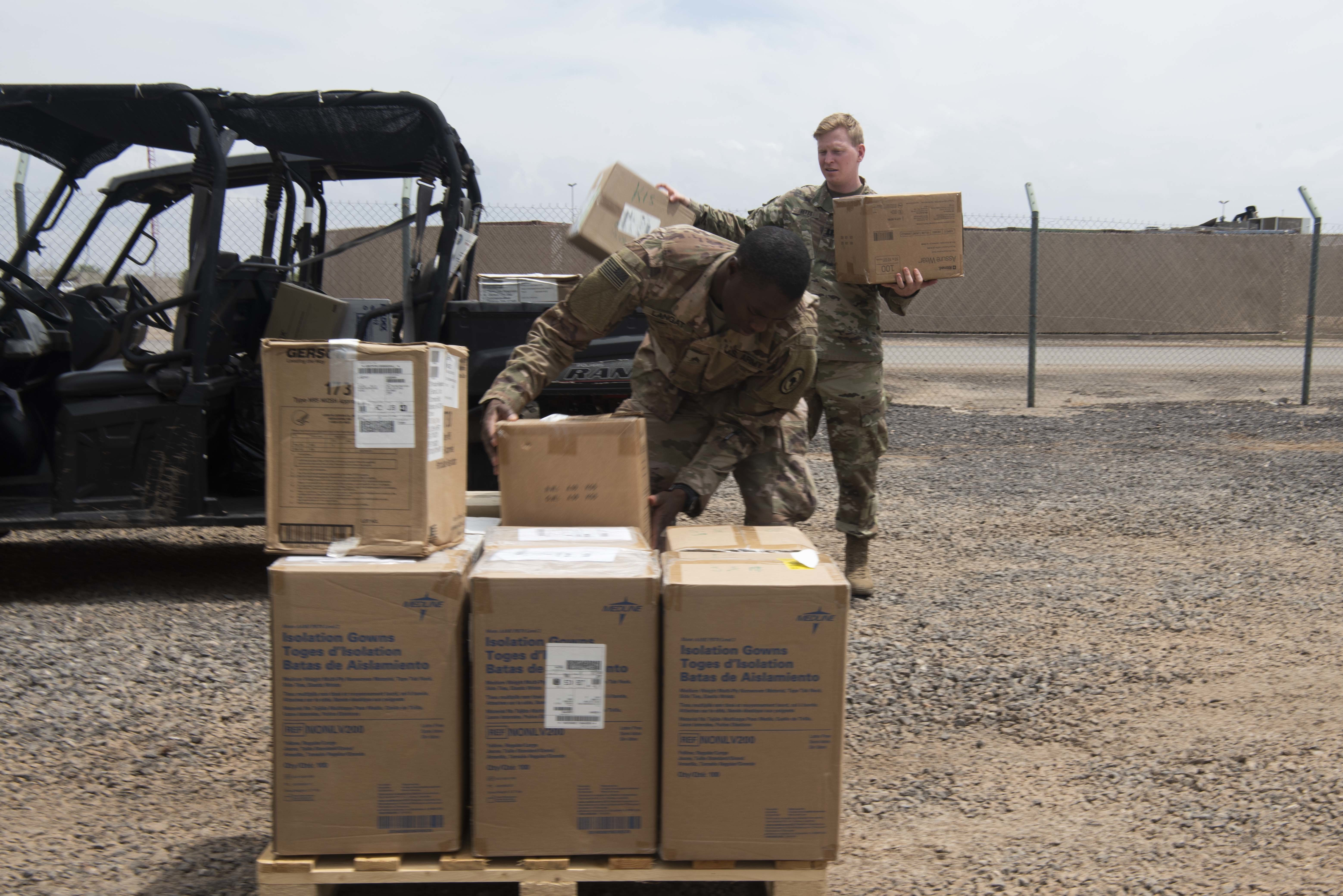 Brian Clark, a project supervisor for the Defense Logistics Agency (DLA), removes a cover from a pallet of medical equipment at Camp Lemonnier, Djibouti, Apr. 22, 2020. The medical equipment is part of Combined Joint Task Force-Horn of Africa's (CJTF-HOA) protective measures for COVID-19 to maintain the health of the force. (U.S. Air Force photo by Tech. Sgt. Ashley Nicole Taylor)