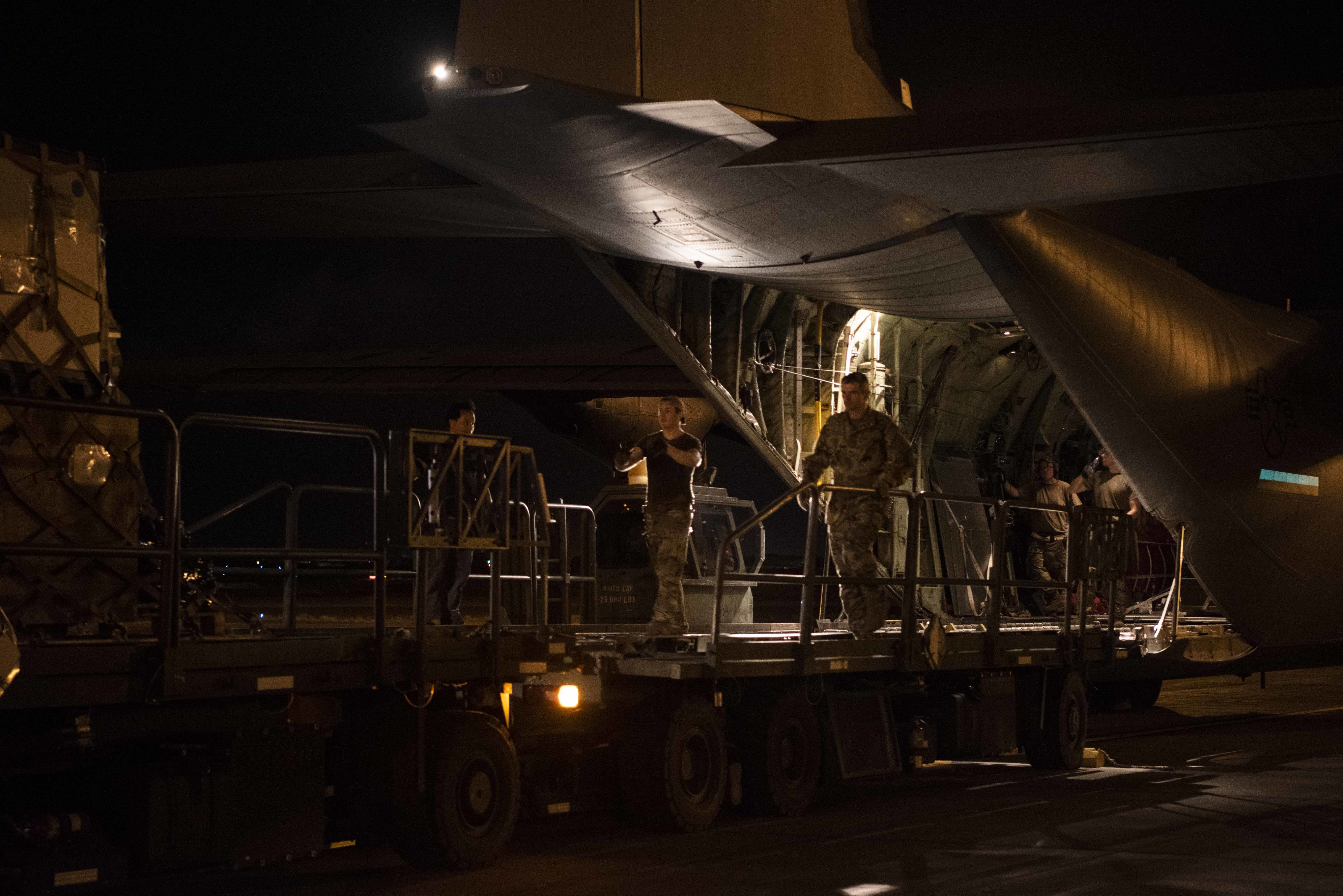 A C-130J Super Hercules transports cargo loaded by U.S. Air Force Airmen assigned to the 75th Expeditionary Airlift Squadron (EAS), in Djibouti, Apr. 27, 2020. The 75th EAS provides strategic airlift capabilities across the Combined Joint Task Force-Horn of Africa area of responsibility and is responsible for moving many of the medical supplies pushed to outstations as part of the COVID-19 pandemic response. (U.S. Air Force photo by Tech. Sgt. Ashley Nicole Taylor)