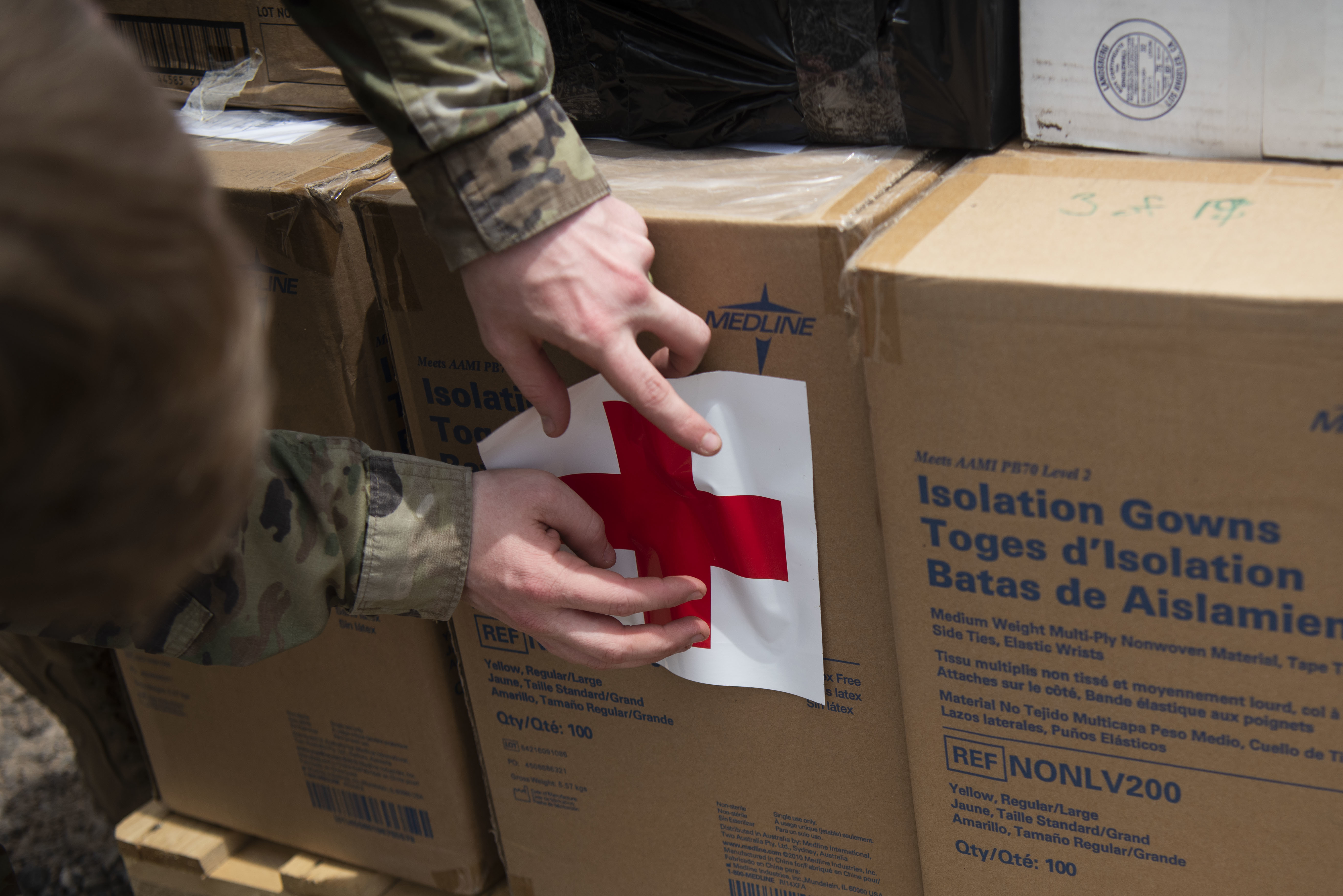U.S. Army Capt. Ethan Betts, medical logistics (MEDLOG) officer for Combined Joint Task Force-Horn of Africa (CJTF-HOA), prepares a shipment of medical supplies at Camp Lemonnier, Djibouti, Apr. 24, 2020. Since the inception of the global COVID-19 pandemic, the MEDLOG team has shipped more than 7,000 surgical masks (facemasks), including 5,000 N95 respirators; 2,500 surgical  gowns; 150 pairs of reusable goggles; and 20,000 pairs of gloves to outstations throughout East Africa. (U.S. Air Force photo by Tech. Sgt. Ashley Nicole Taylor)