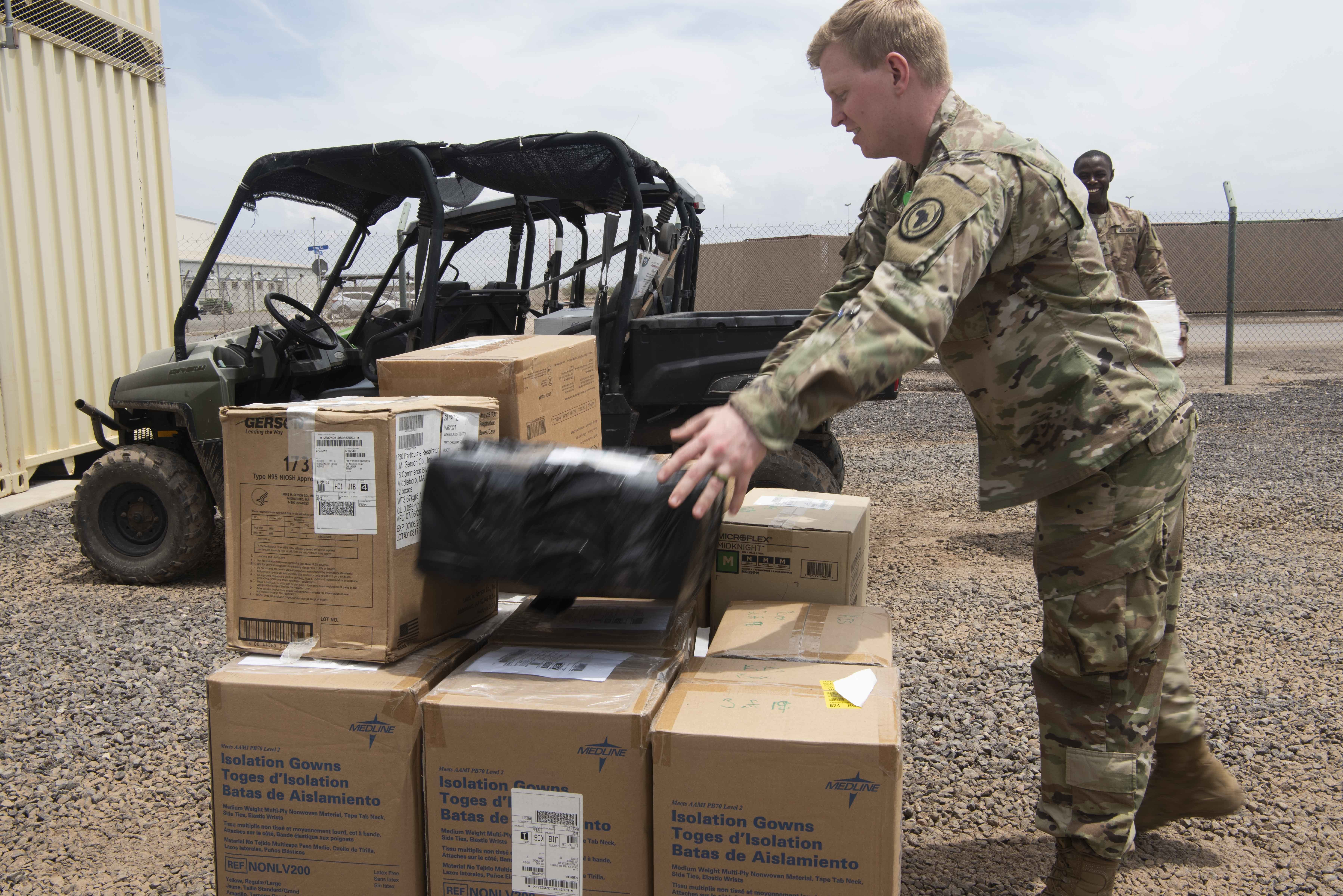U.S. Army Capt. Ethan Betts, medical logistics (MEDLOG) officer for Combined Joint Task Force-Horn of Africa (CJTF-HOA), places a medical sticker on a box of medical supplies at Camp Lemonnier, Djibouti, Apr. 24, 2020. CJTF-HOA's MEDLOG is responsible for distributing supplies and healthcare equipment, whether it be a computer system, a bandage, narcotics or PPE, to medical providers anywhere in East Africa. (U.S. Air Force photo by Tech. Sgt. Ashley Nicole Taylor)